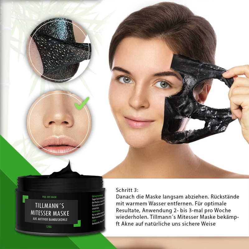 Beautiful woman is applying purifying black mask on her face